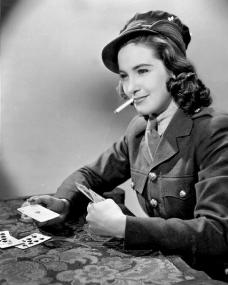 Patricia Roc smokes while she plays cards