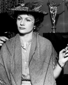Margaret Lockwood smokes while she wears a shawl