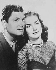 Anthony Steel (as Captain Harry Wilding) and Patricia Roc (as Anne Wilding) in a photograph from Something Money Can't Buy (1952) (4)