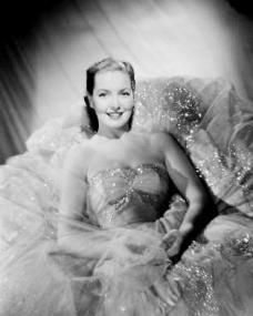 Patricia Roc smiles broadly in a sparkling ballgown