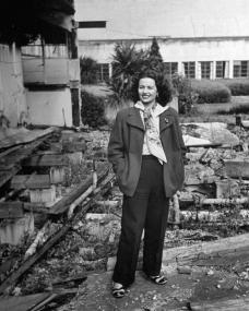 Margaret Lockwood stands in the grounds of a ruined building