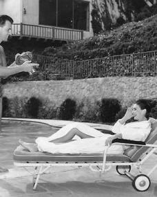 Stewart Granger cinefilms Jean Simmons while lazing by their pool