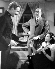 Randolph Scott (as Inspector Angus 'Monty' Montague), Lester Matthews (as Harlan Chambers) and Margaret Lockwood (as Vicky Standing) in a photograph from Susannah of the Mounties (1939) (10)