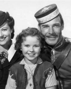 Margaret Lockwood (as Vicky Standing), Shirley Temple (as Susannah Sheldon) and Randolph Scott (as Inspector Angus 'Monty' Montague) in a photograph from Susannah of the Mounties (1939) (3)