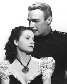 Margaret Lockwood (as Vicky Standing) and Randolph Scott (as Inspector Angus 'Monty' Montague) in a photograph from Susannah of the Mounties (1939) (4)