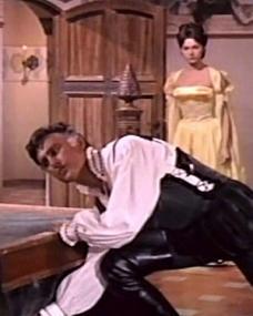 Stewart Granger (as Thomas Stanswood) and Sylva Koscina (as Orietta Arconti) in a screenshot from Swordsman of Siena (1962) (3)