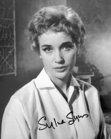 Photograph featuring British actress, Sylvia Syms, wearing a white blouse. Signed by the actress