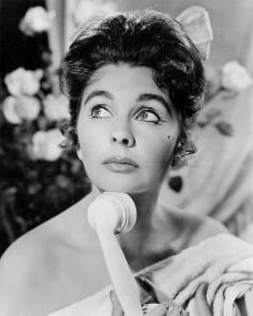 British actress Jean Simmons looks thoughtful as she holds the telephone receiver