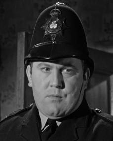 Police Constable Wells (Terry Scott) discovers a crime in the 1964 film, Murder Most Foul