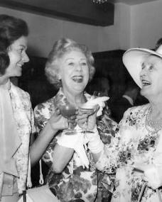 Margaret Lockwood and Cicely Courtneidge raise a toast to Sybil Thorndike