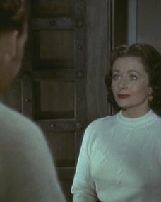 Forrest Tucker (as Major Lance Lansing) and Margaret Lockwood (as Marissa Menzies) in a screenshot from Trouble in the Glen (1954) (4)