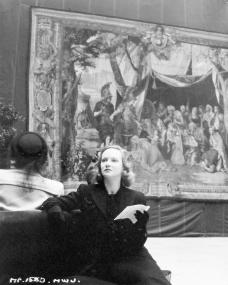 Joan Greenwood takes a breather from appreciating all the tapestries in this candid shot from the Victoria and Albert museum