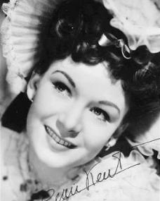 Jean Kent wears a white hat in an autographed picture