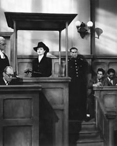 Lucy Glover (Margaret Lockwood) takes the oath as she enters the witness box to plead for leniency for Lottie Smith who is accused of attempting to murder her child