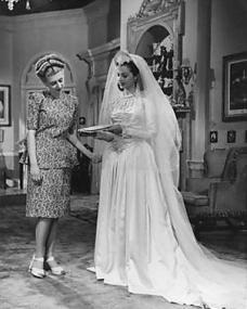 Margaret Lockwood and the continuity girl reviewing a scene for the wedding on the set of John Corfield's The White Unicorn