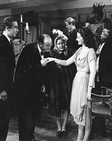 The schoolmaster (Jan van Loewn) and his wife take leave of their host and hostess Dick (Dennis Price) and Lucy (Margaret Lockwood) and thank them for a delightful party