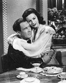 'I'd like to have champagne every day,' says Lucy Templar (Margaret Lockwood) to her newly married husband, Philip (Ian Hunter). 'And so you shall,' he replies.