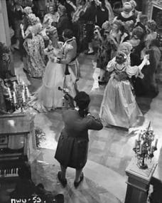 Lucy (Margaret Lockwood) is very happy with the success of her fancy dress ball. She danced often with Dick (Dennis Price) who is dressed to resemble the Earl of Hartland