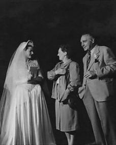 Margaret Lockwood greeting visitors to the set of The White Unicorn at Nettlefold Studios.    Chrissie White and Henry Edwards, stars of the silent screen, play guests at the wedding scene