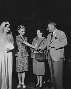 Margaret Lockwood greeting visitors on the set of The White Unicorn, being filmed at Nettlefold Studios.    Chrissie White and Henry Edwards are meeting the continuity girl.    Stewart Rome looks on