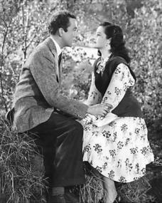 In a vain effort to save her marriage, Lucy (Margaret Lockwood) suggests to Dick (Dennis Price) that he should drive her to the cottage where Norey is staying with her nurse so that she can bring her back home.  On the way the car breaks down and Lucy and Dick sit on a grassy bank – 'In these woods I lost a white unicorn; I was broken hearted,' says Dick.  'White unicorn?,' Lucy replies.  'Yes, my father says it was the symbol of happiness,' Dick tells her.  'Now I've found it again – in you.'