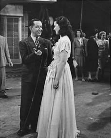 Margaret Lockwood being interviewed at a party to celebrate the golden jubilee of Nettlefold Studios