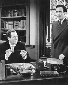 Dick Glover (Dennis Price) tells Lucy's (Margaret Lockwood) husband Phillip Templar (Ian Hunter) that he and Lucy are in love and want to be married if she can get a divorce