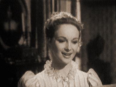Lady Caroline reads Byron's poem, She Walks in Beauty.    Joan Greenwood and Dennis Price in a film clip from The Bad Lord Byron