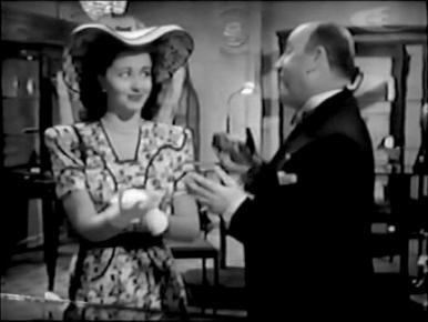 Henry de Bray and Margaret Lockwood in a film clip from Bedelia