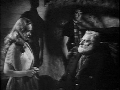 Mary (Patricia Roc) is accused by Hector (Finlay Currie) of bringing shame on the Macrae familty