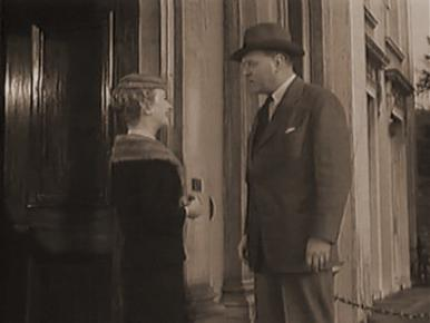 Joan Greenwood and John Horsley in a film clip from Father Brown