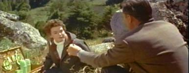 While blackberry picking, Harry (Stewart Granger) tells Christian (Barbara Rush) of his past