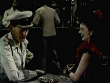 Margaret Lockwood and Wendell Corey in a film clip from Laughing Anne