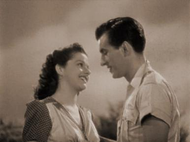 Lissa (Margaret Lockwood) manages to resist the advances of the blunt, rugged Kit (Stewart Granger).    Film clip from Love Story (1944)