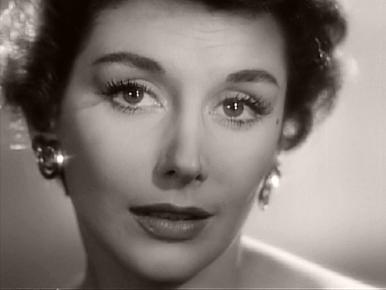 The Lonely Hearts Singer (Kay Kendall) sings out from the television set in Ealing's Meet Mr Lucifer (1953)