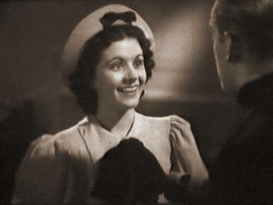 Hughie Green and Margaret Lockwood in a film clip from Melody and Romance