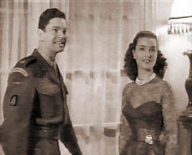 Captain Wilding (Anthony Steel) and Anne (Patricia Roc)