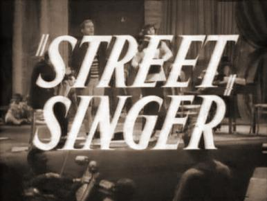 Arthur Tracy, Arthur Riscoe and Margaret Lockwood in a film clip from The Street Singer