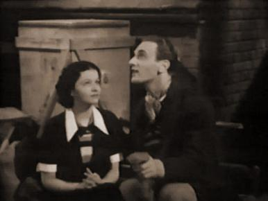 Arthur Tracy and Margaret Lockwood in a film clip from The Street Singer