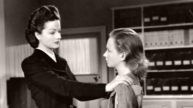 Lucy (Margaret Lockwood) puts her arms on the shoulders of Lottie Smith (Joan Greenwood) in a scene from The White Unicorn (1947)