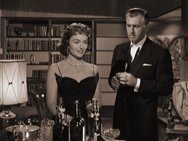 Max (Stewart Granger) admits to Carol (Donna Reed) his affair with the fiery actress Gina Bertini