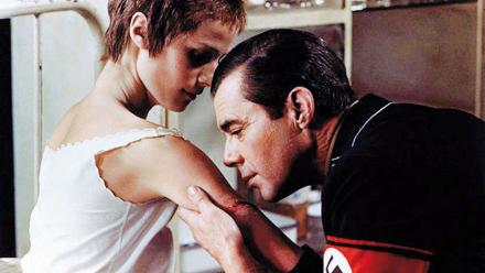 Max (Dirk Bogarde) in Nazi uniform tends to Lucia (Charlotte Rampling) in a scene from the 1974 film, The Night Porter
