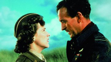 June (Kim Hunter) and Peter (David Niven) in uniform look at each other in A Matter of Life and Death