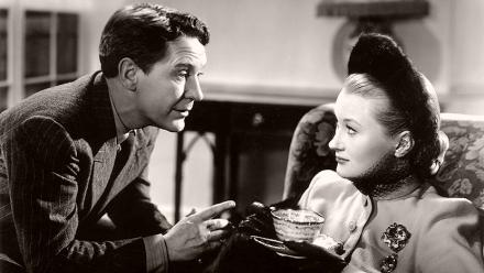Felix Milne (Burgess Meredith) talks to Barbara 'Babs' Edge (Christine Norden) as she drinks tea in Mine Own Executioner (1947)