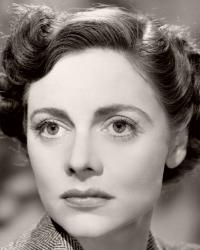 British actress Celia Johnson in a promotional picture for the film Brief Encounter (1945).  Johnson pairs a smart herringbone jacket with jumper and pearls