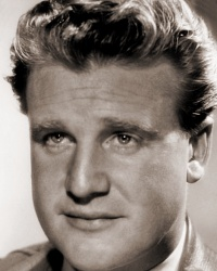 British actor Donald Houston wears a jacket and tie