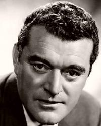 British actor Jack Hawkins wears a jacket and tie
