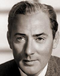British actor Michael Wilding wears a jacket and tie