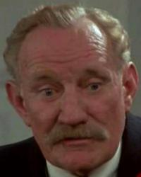 'Saltie' (Trevor Howard) meets with the Parish Council in a scene from the 1980 Inner Circle Films production of The Shillingbury Blowers