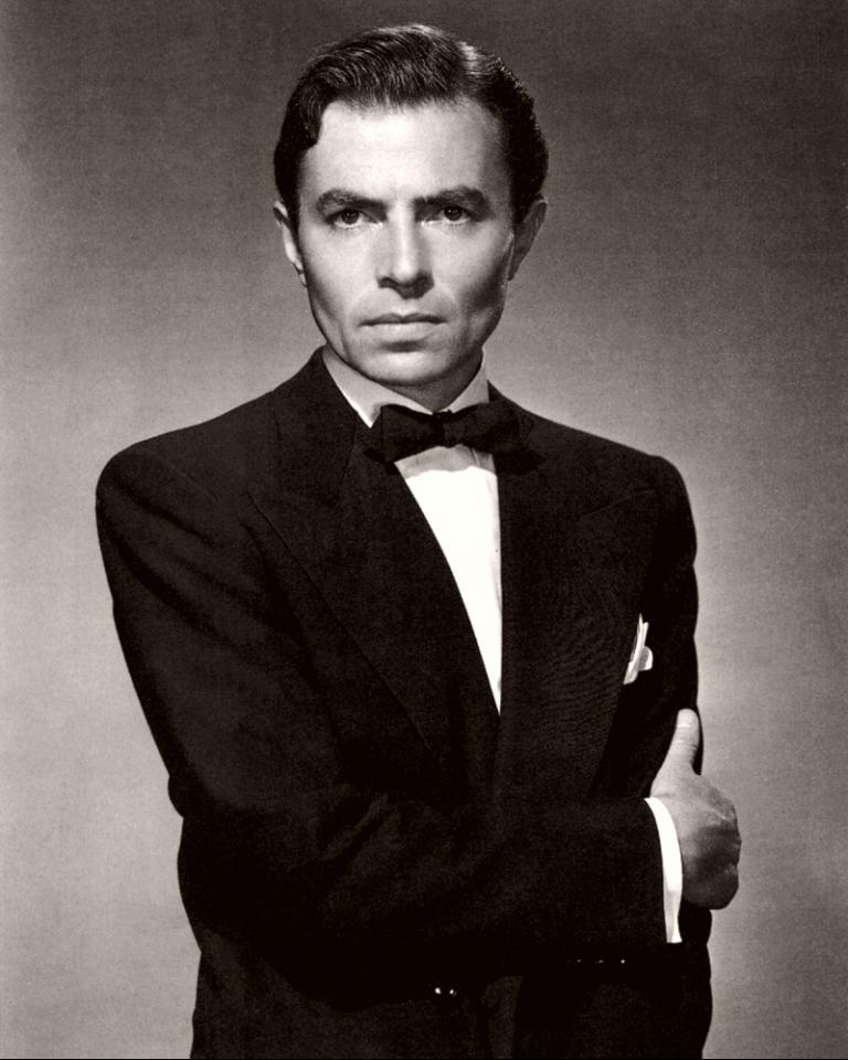 British actor James Mason wears a black dinner jacket and bow tie